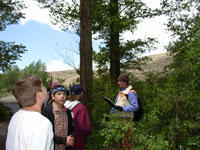 Students learn about vegetation assessment along Warm Springs Creek in Washoe Park in Anaconda, Montana.